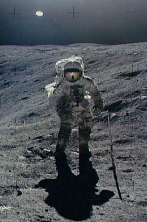 Apollo 16 astronaut standing on the moon