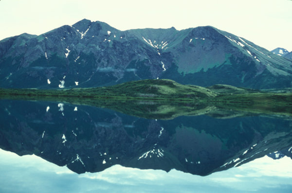 Distant mountain being reflected in a lake